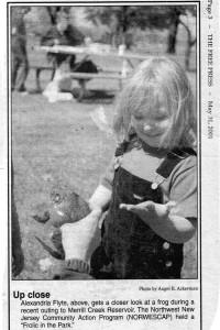 Preschooler touches a frog