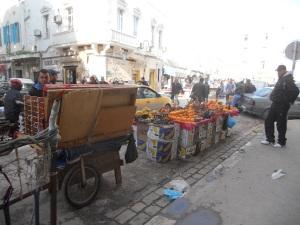 Street vendor with oranges
