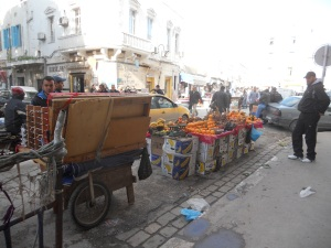 Street vendor with oranges