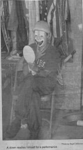 A clown prepares for the circus