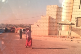 As we pull into the square... I noticed a woman adding what looked like sugar to a tea kettle.